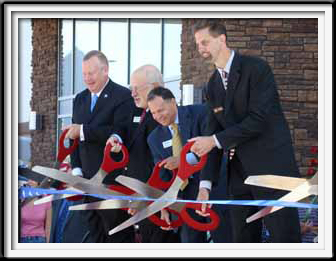 Giant Red Scissors Ribbon Cutting