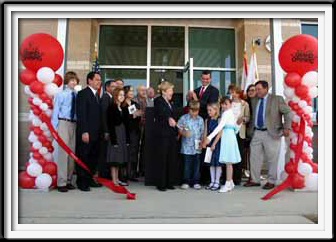 Red and White Ribbon Cutting